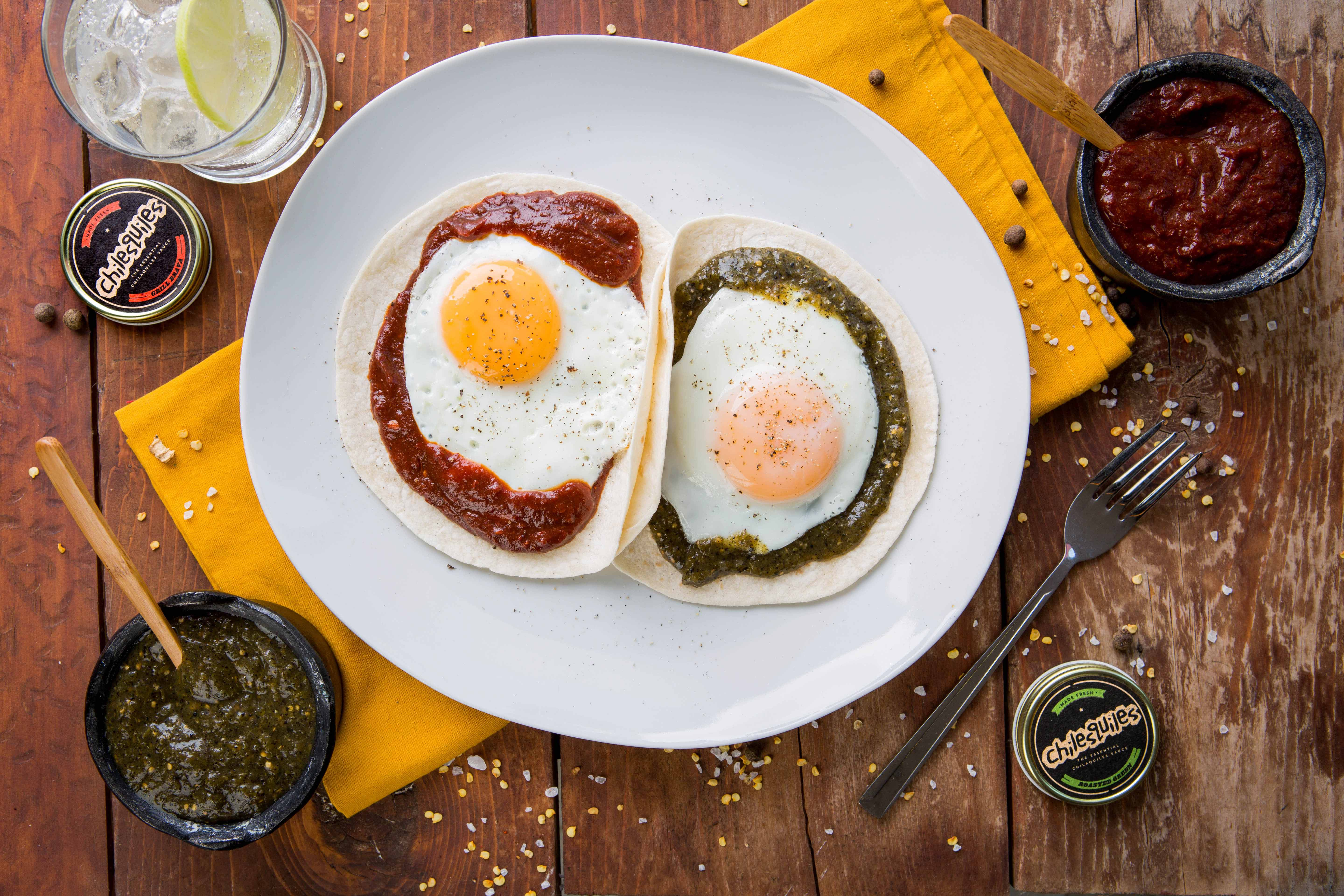 HUEVOS DIVORCIADOS WITH SIGNATURE RED AND ROASTED GREEN